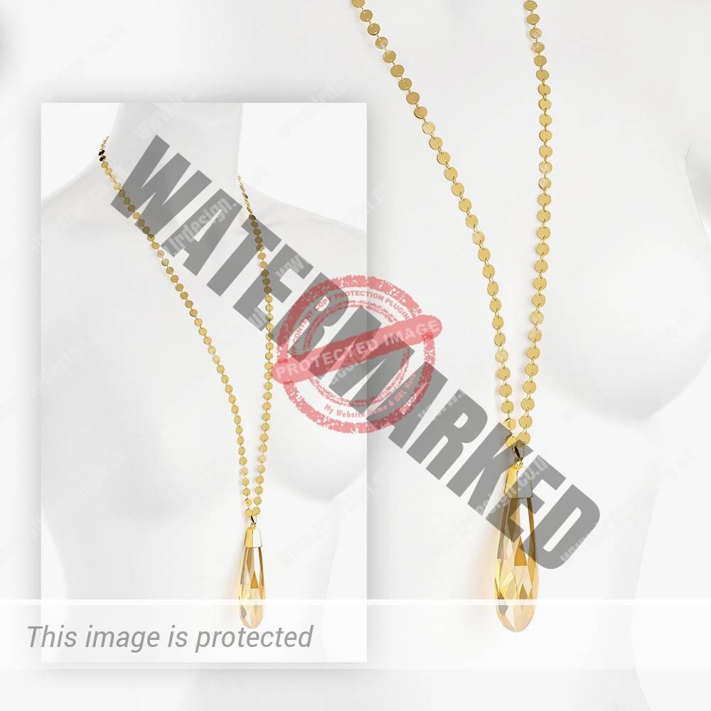 Long gold pendant necklace.