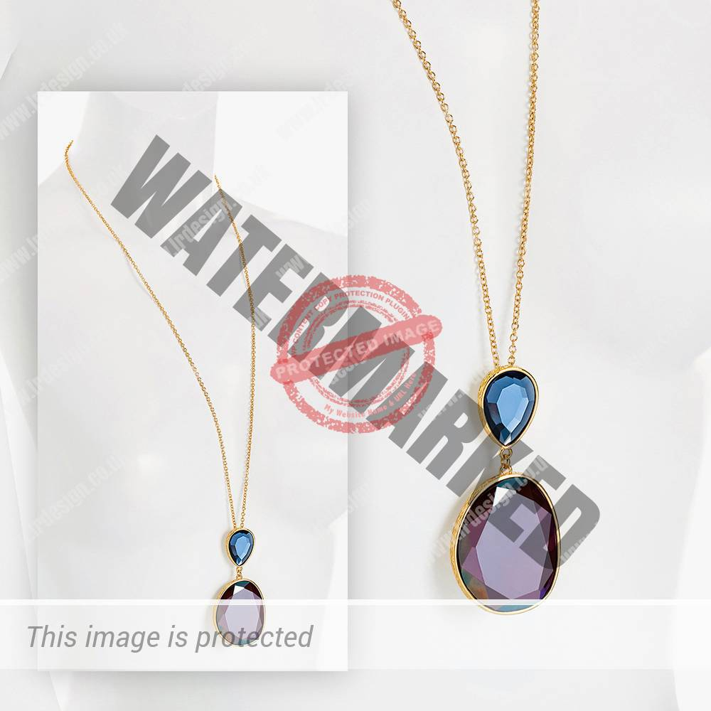 Gold necklace with a blue and purple pendant.