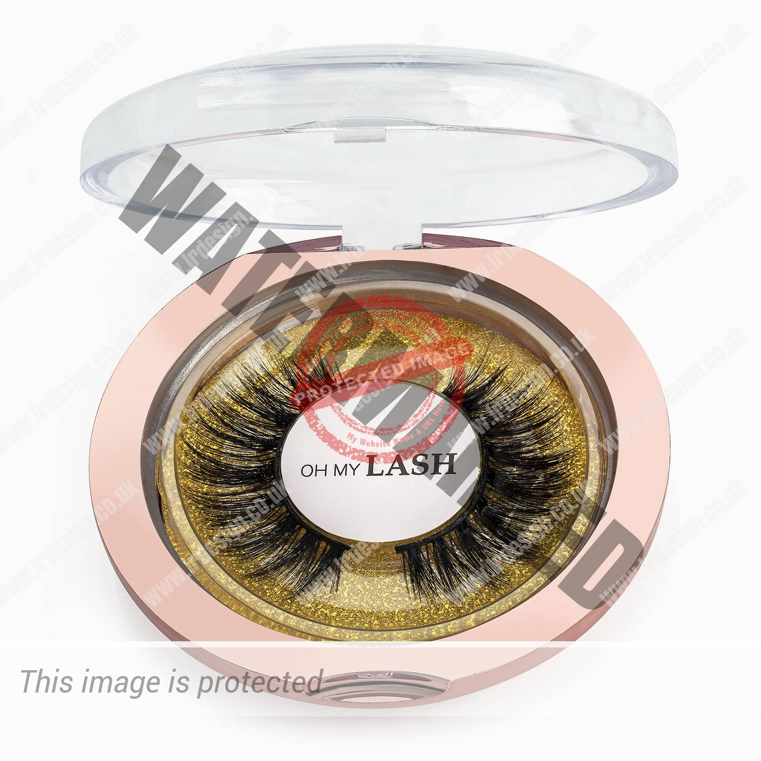 Close up of Oh My Lash gold compact.