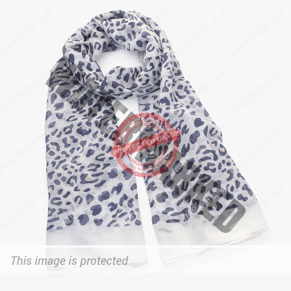 Pale coloured scarf with blue grey print.