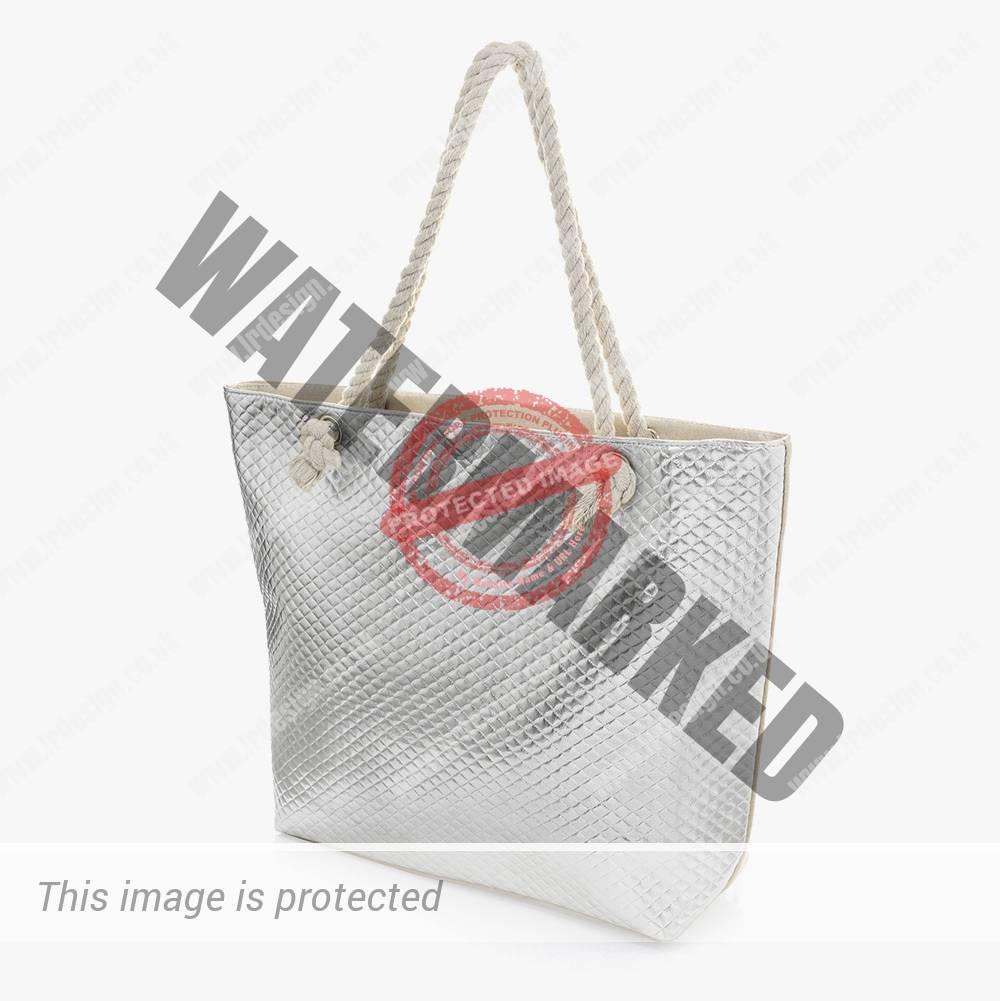 Metallic silver rope string bag.