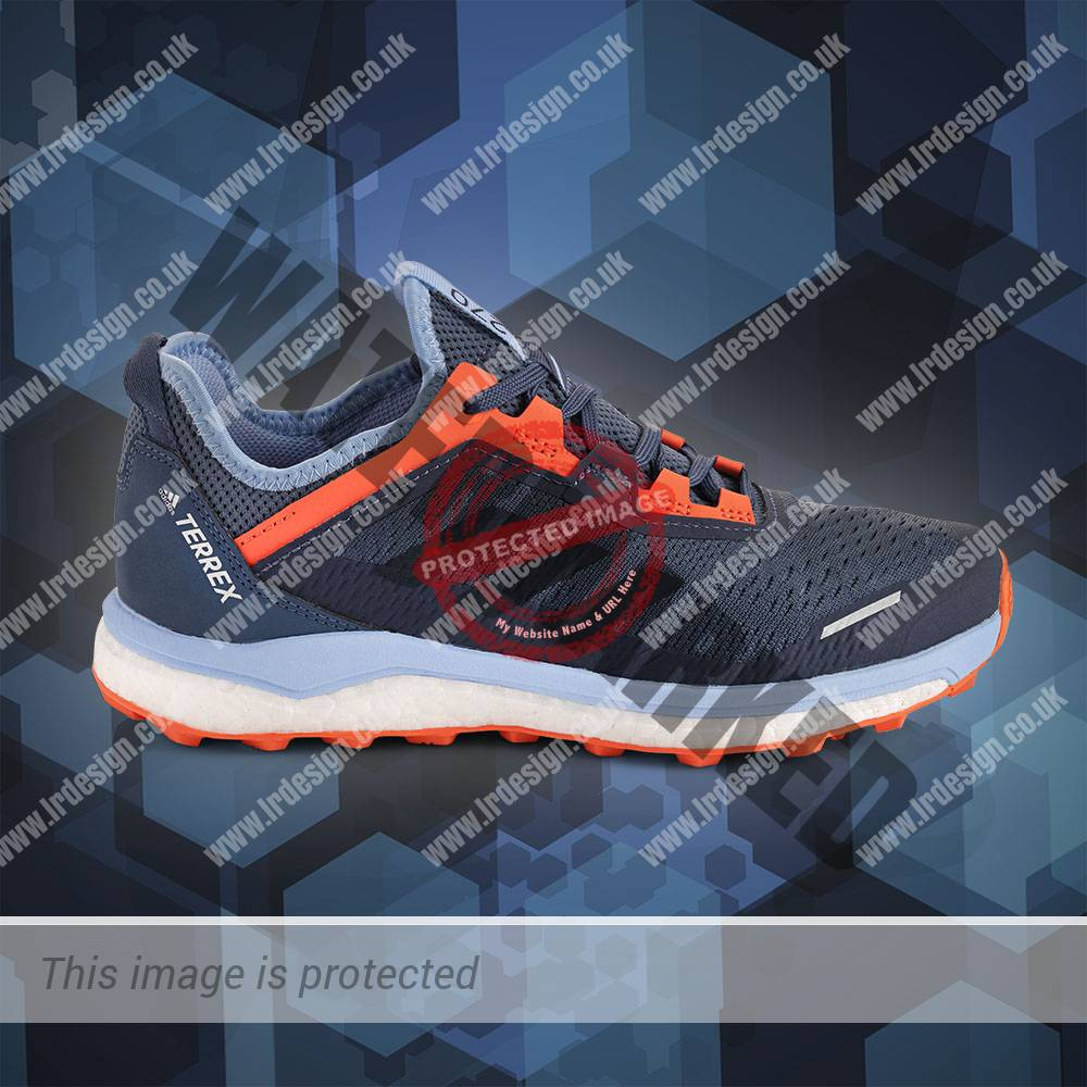 Side view image of a pair of women's running sports shoes.