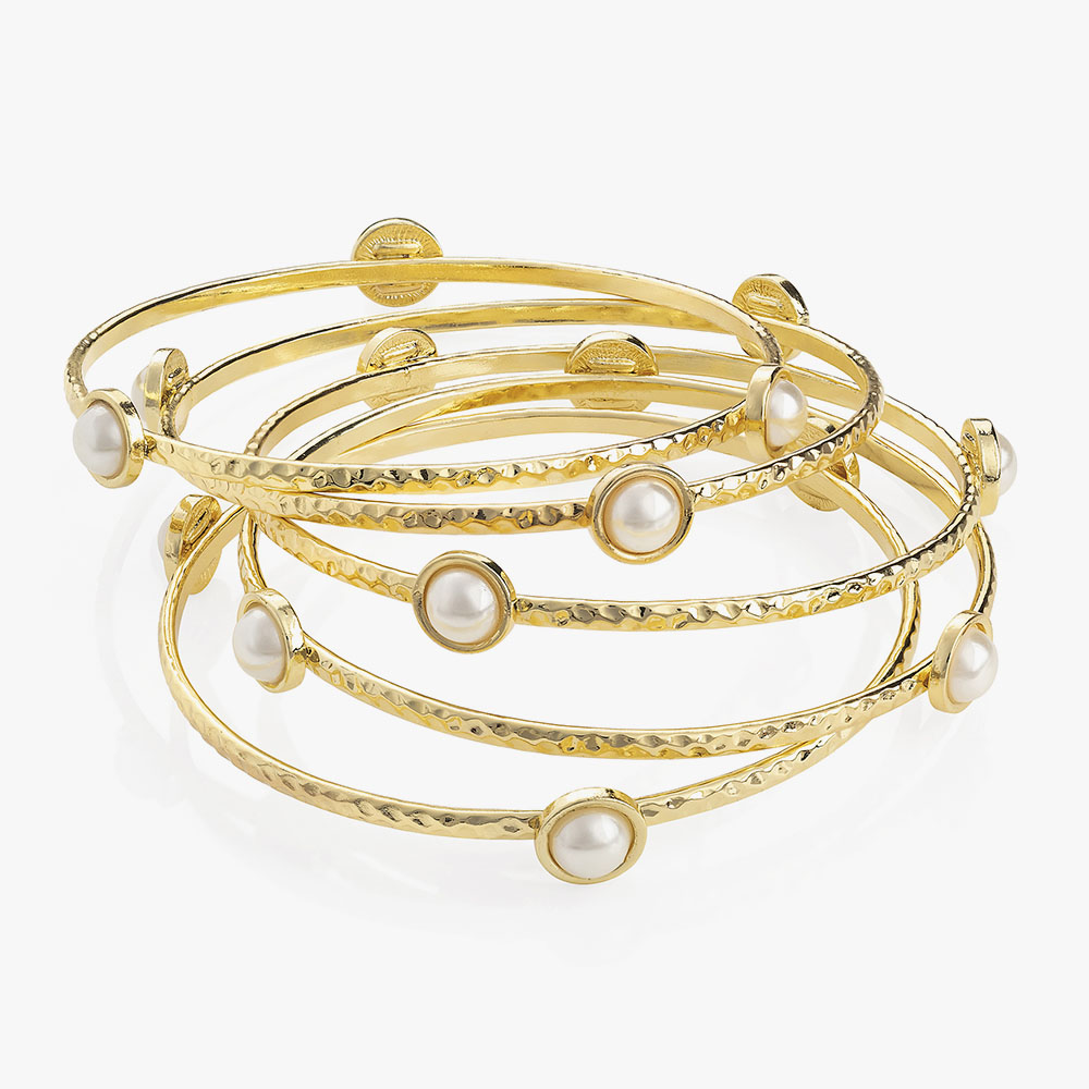 Five piece gold bangle set.