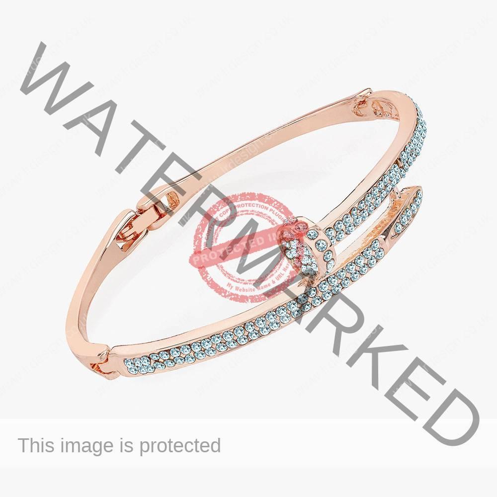 Rose gold crystal bangle.