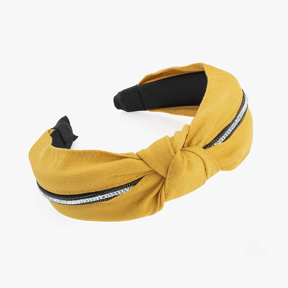 Mustard yellow coloured headband.