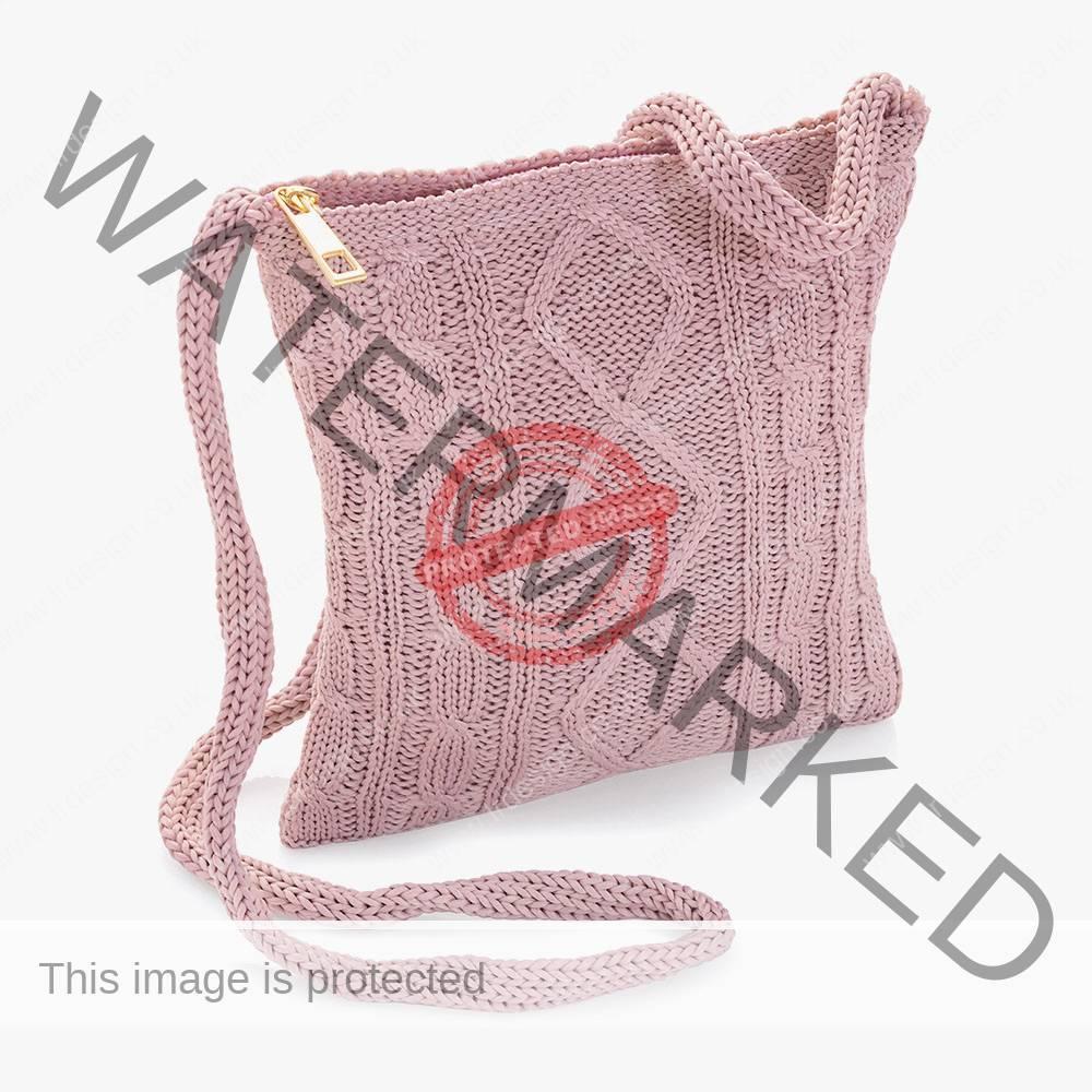 Dusky pink knitted cross body bag.