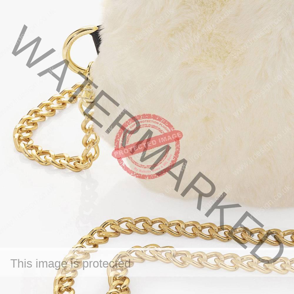 Corner close up detail of a cream faux handbag.