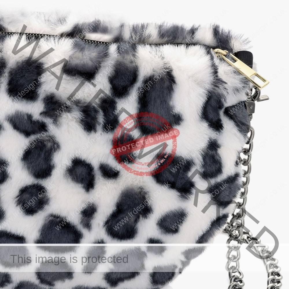 Corner close up detail of a faux handbag.