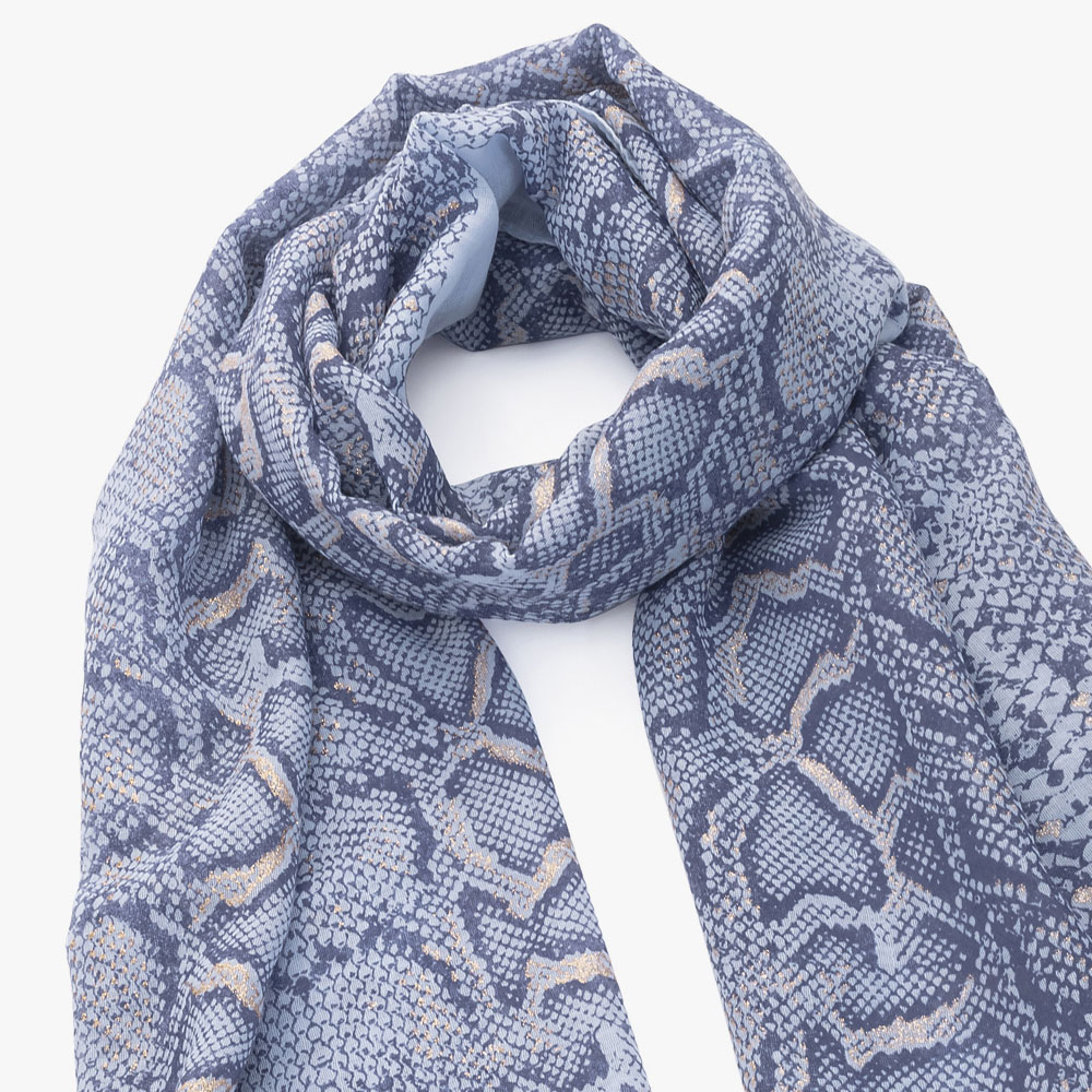 Close up of animal printed scarf.