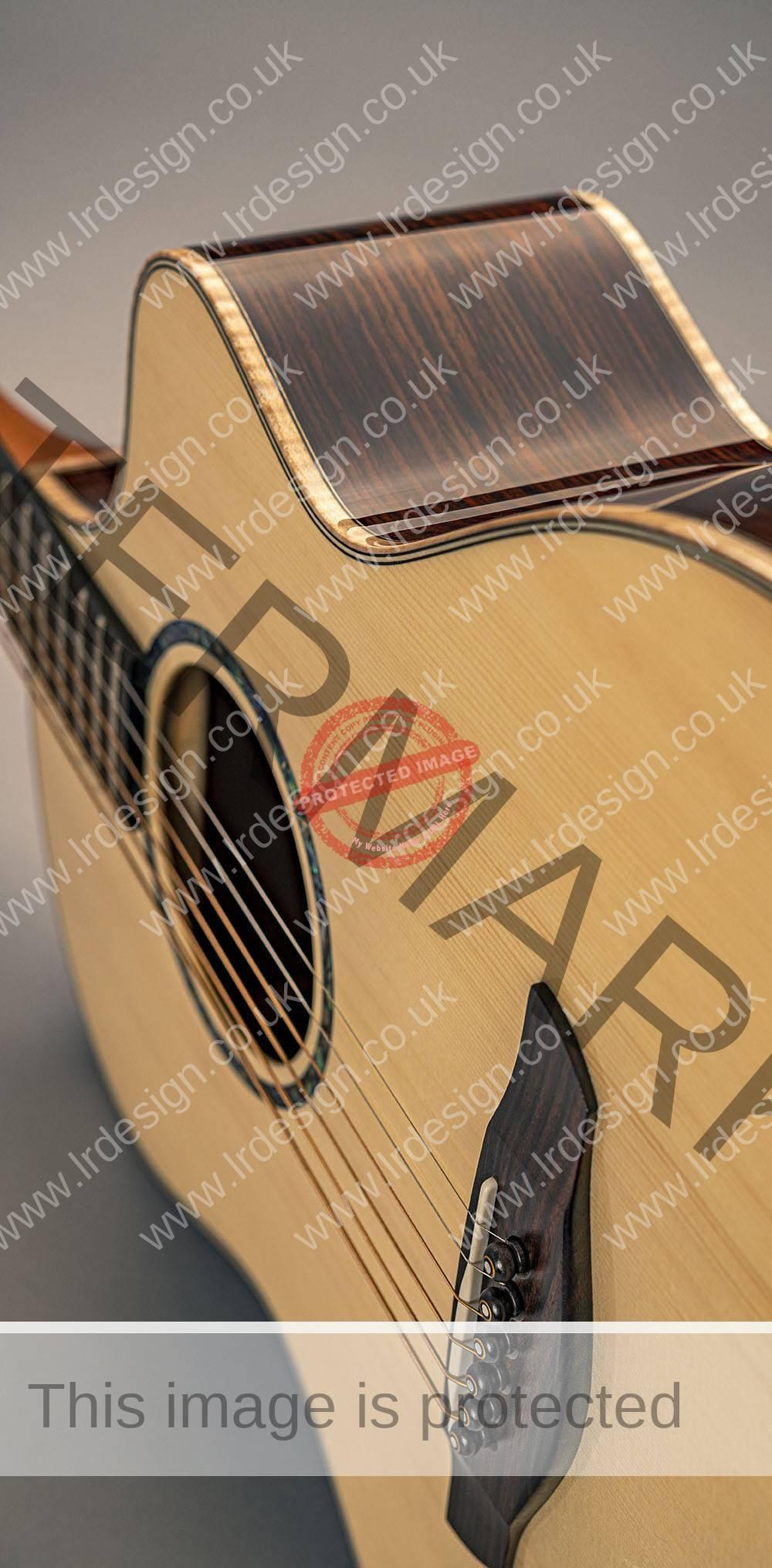 Faith acoustic guitar side view.